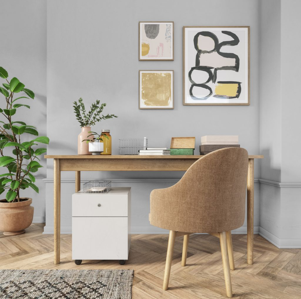 A simple Bohemian style home office, the wall color is a light gray called Silver Bullet.