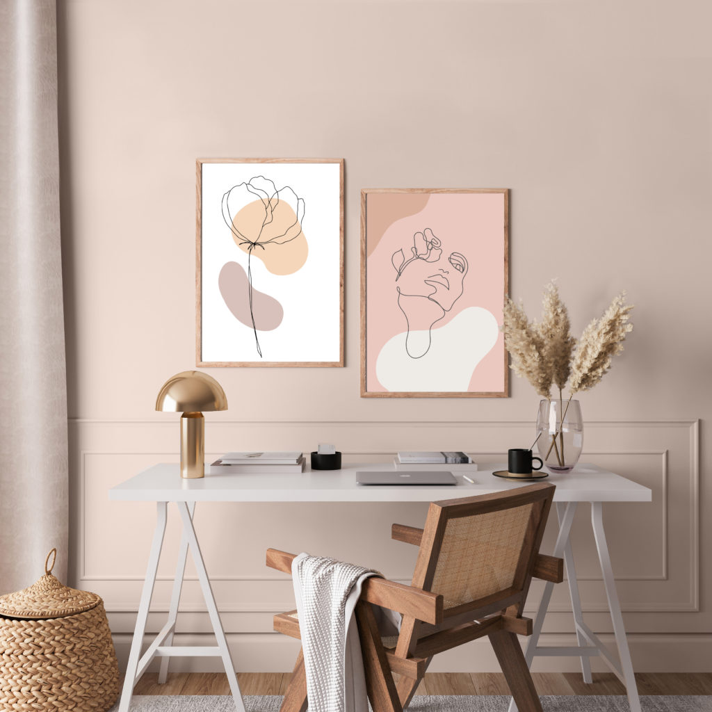 A Scandinavian interior. there is  rattan chair and white desk in home office room design.  The wall is painted in a light dusty pink color called Seaside Villa.