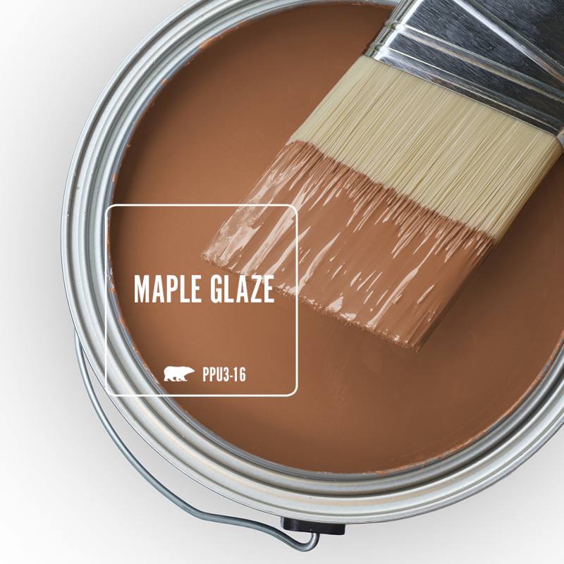 The top view of and open paint can with a half dipped paint brush, the paint color being featured is called Maple Glaze.