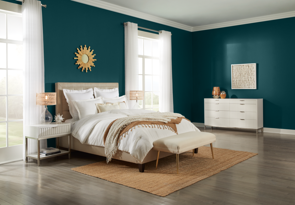 A contemporary bedroom featuring a deep, nautical teal for relaxed and sophisticated spaces called Ocean Abyss.