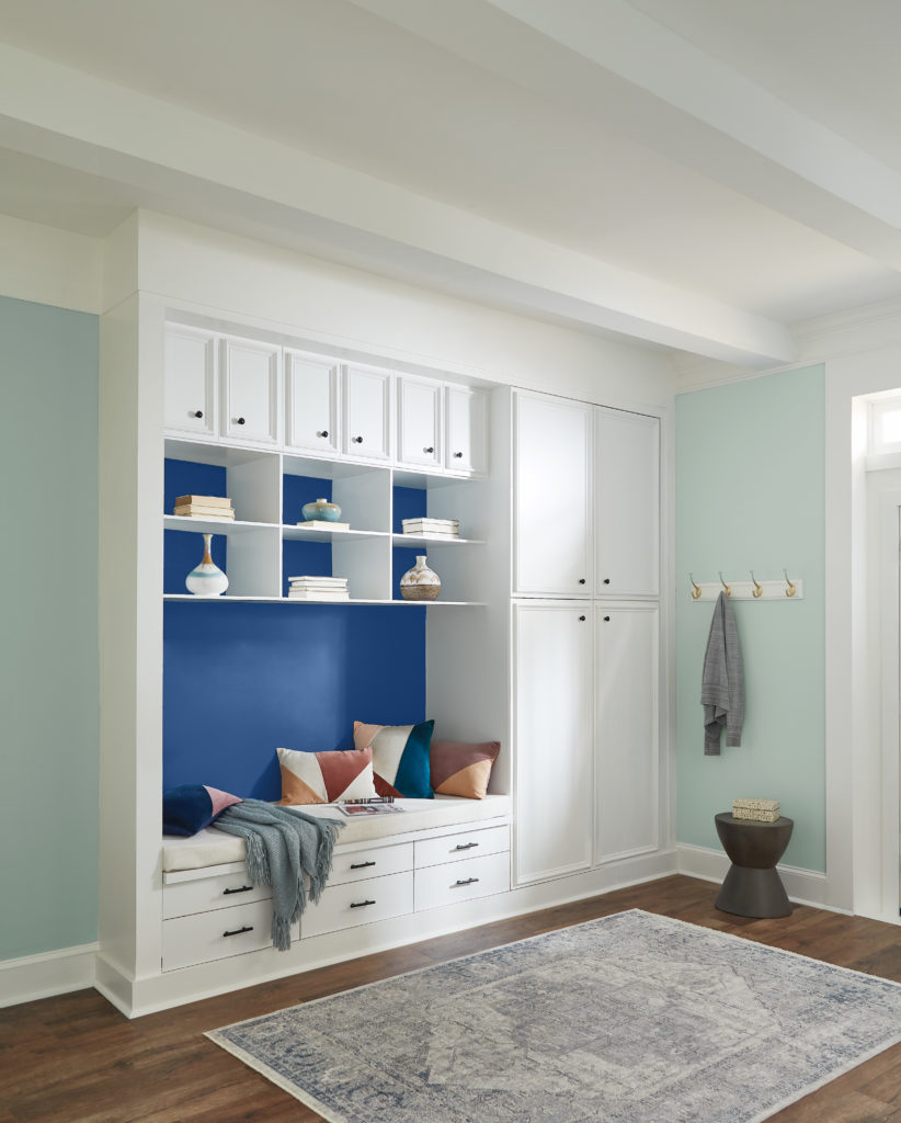 A casual mud room area painted in two color, a light color called Breezeway and an accent color called Dark Cobalt Blue.