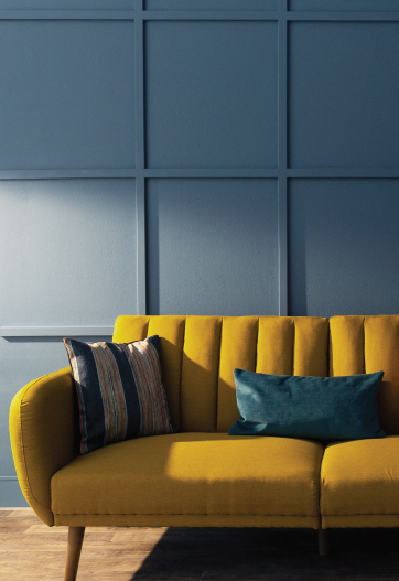 A living room with a decorative wall painted in blue.