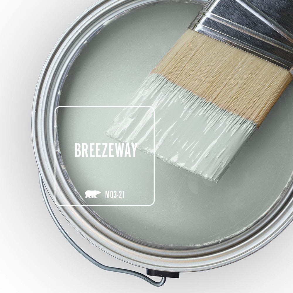 The top view of an open paint can, the paint color being features is Breezeway.  A silvery green shade with cool undertones.