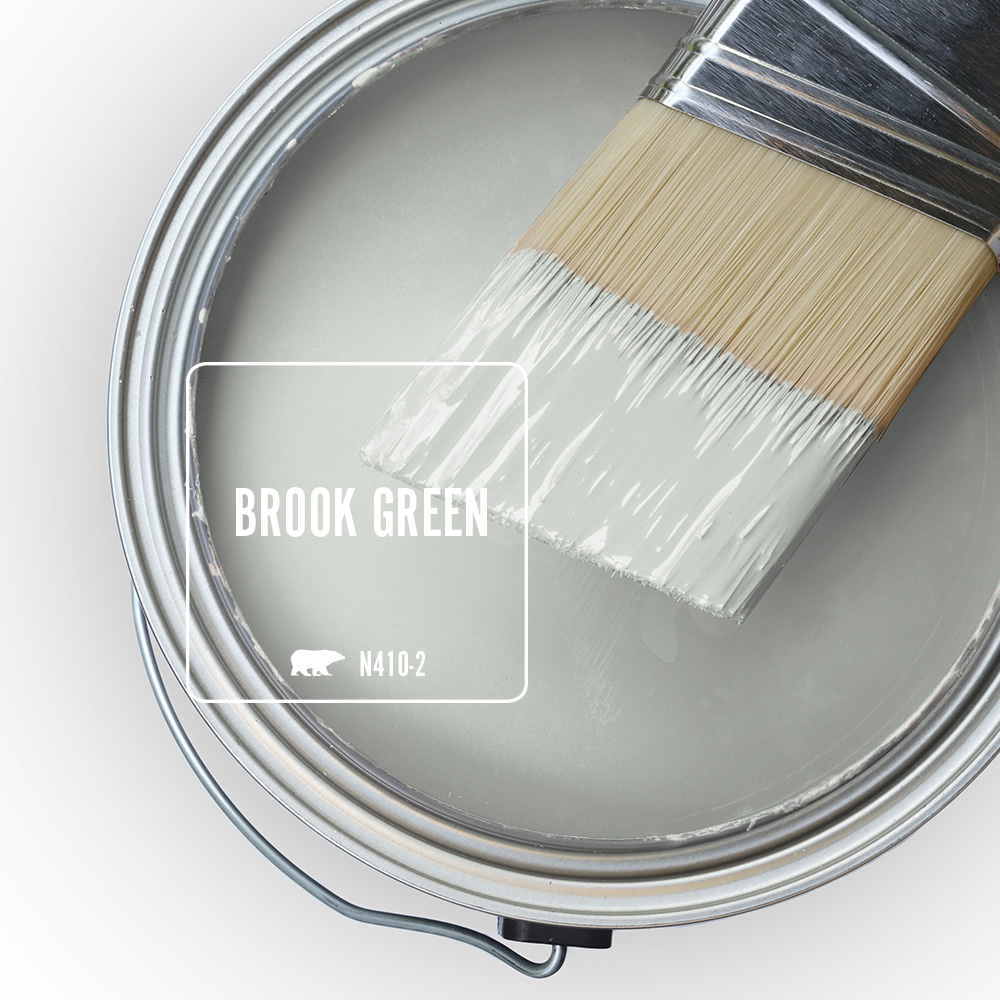 A paint swatch of the light green color Brook Green.