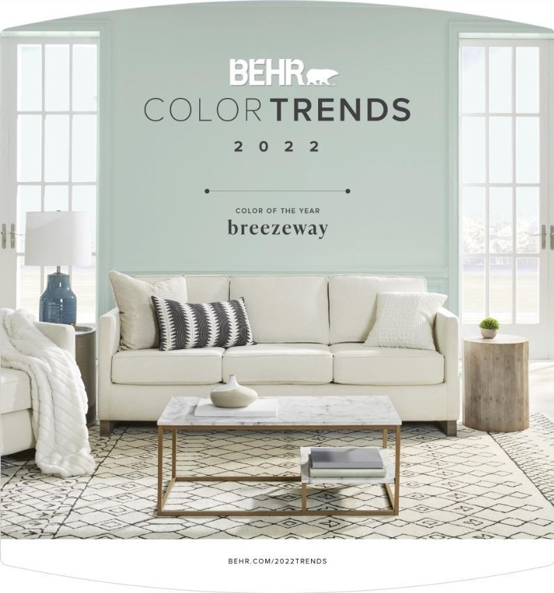 The cover of the 2022 BEHR Trends brochure which features BEHR's 2022 Color of the Year in a beach cottage style living room.