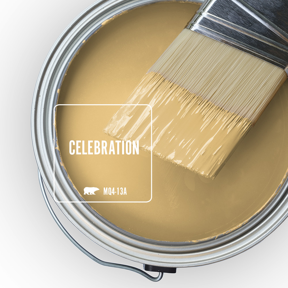 The top of an open paint can showing the color celebration inside.