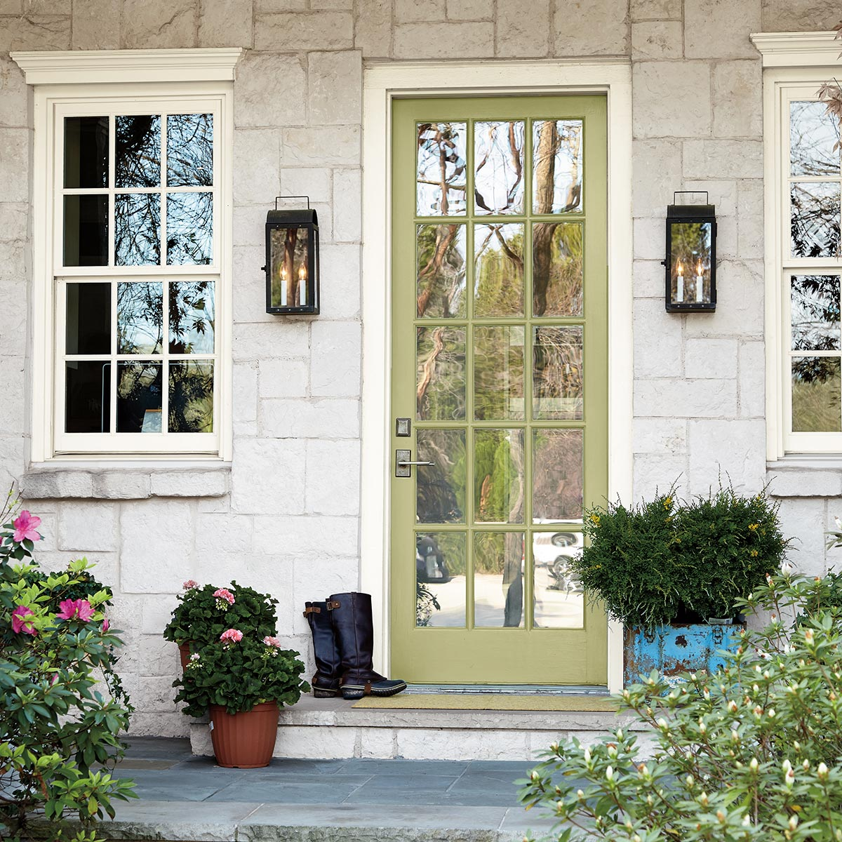 Front door is painted Behr Back to Nature - the 2020 Color of the year, bringing a calm yellowy-green option with a natural vibe! #paintcolor #greenpaint #calmpaintcolor