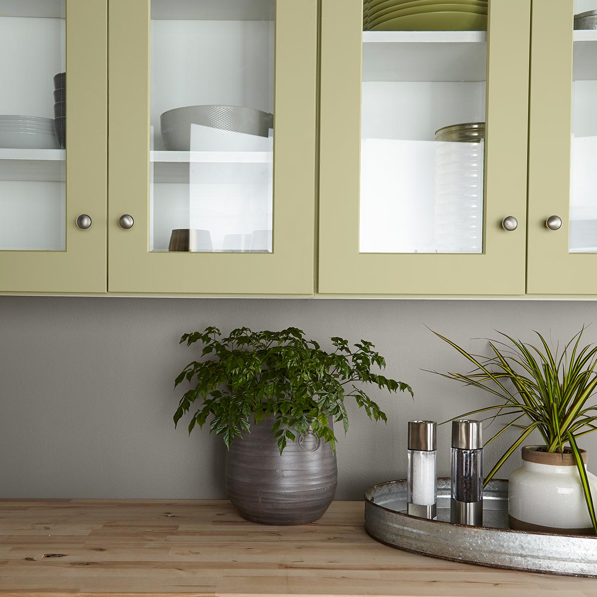 Behr Back to Nature paint color is the 2020 Color of the year, bringing a calm yellowy-green option with a natural vibe! #paintcolor #greenpaint #calmpaintcolor