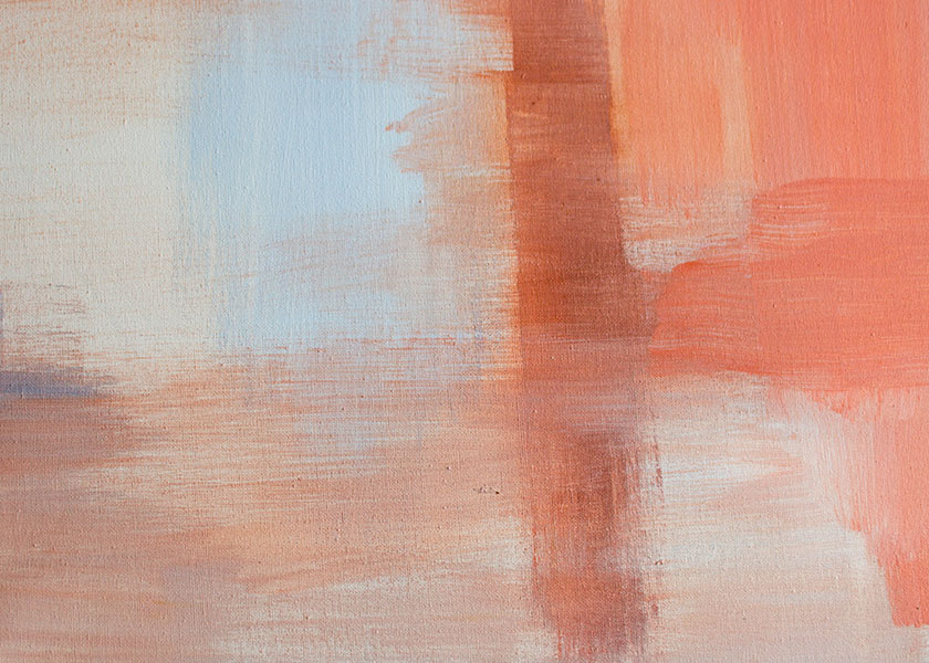 A canvas with an abstract drawing using colors that are both muted and bright orange hues. There are also slight touches of a blue hue representing a sky and nature reflecting on a body of water.
