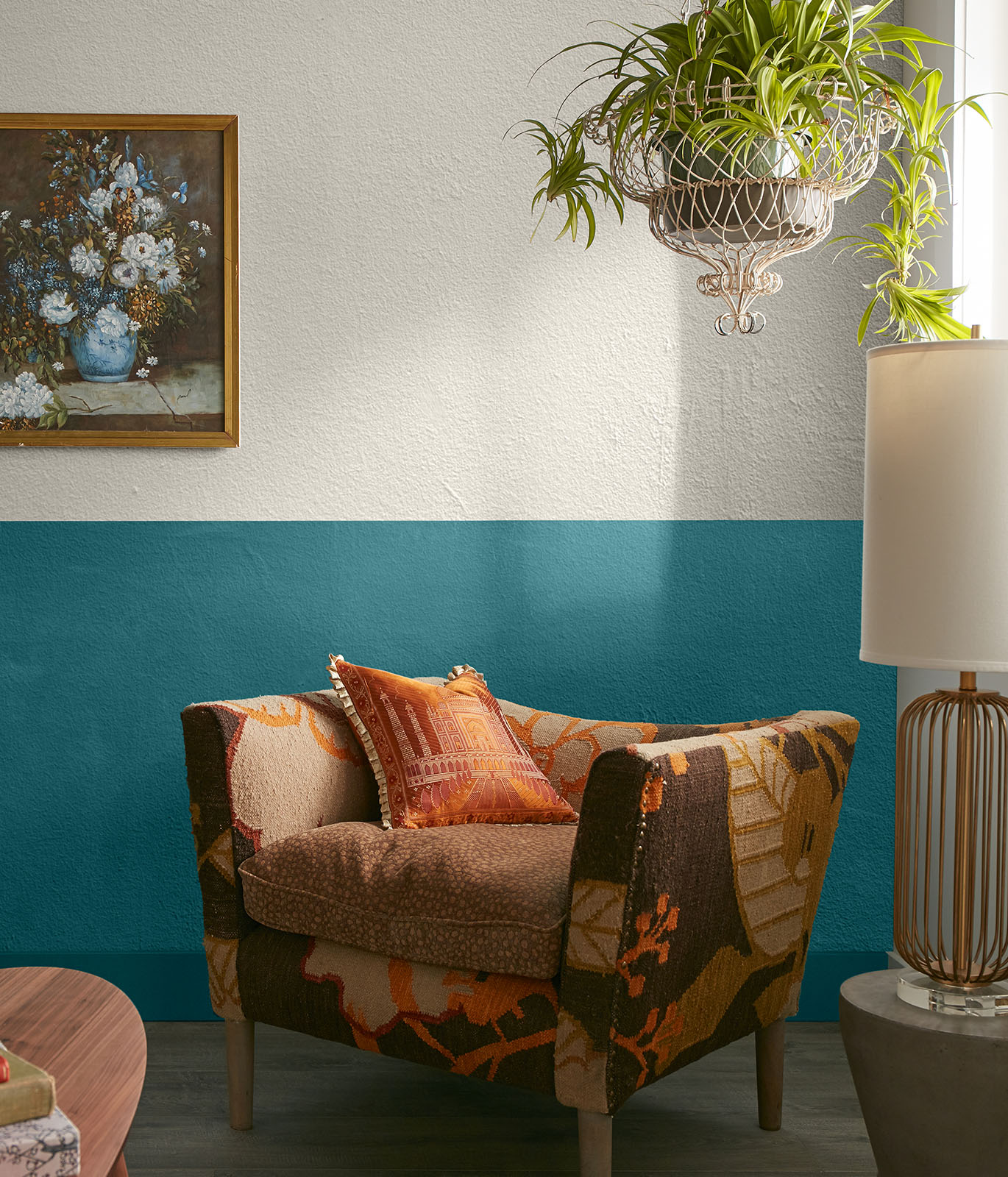 A sitting area with the walls painted in white and blue. A comfy chair sits in the corner. The mood is buoyant.